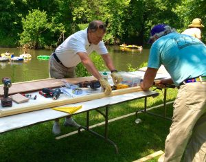 Volunteers put together the boat that is now on display at the Brandywine River Museum of Art.