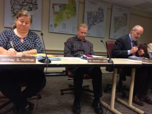Kennett Township Supervisors Whitney S. Hoffman (from left), Richard L. Leff, and Scudder G. Stevens review materials during Wednesday night's meeting.
