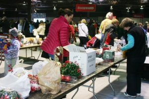 Patrons survey a wide range of items for sale at the 2015 Whale of a Sale.