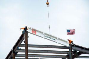 Crews put the beam in place.