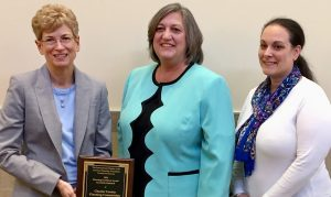 Carol Stauffer (from left), Chester County infrastructure and plan review director; Chester County Commissioner Kathi Cozzone; and Carrie Conwell, Chester County senior environmental planner, display the award..