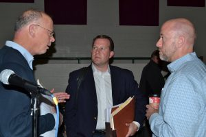 After the meeting, John Snook (left), an East Bradford Township supervisor and planner for the Brandywine Conservancy, chats with Toll representatives Greg and Andrew J. Semon.