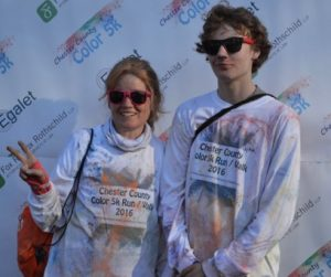 Jean Shavor of Downingtown is shown with her 17-year-old son Brad celebrate the completion of the race.