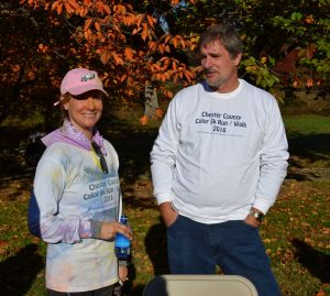 Chester County Commissioner Michelle Kichline (left) chats with Vince Brown, who heads the county's Drug & Alcohol Services, after the race.