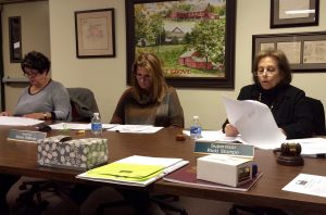 Pocopson Township Supervisors Alice Balsama (from left) and Elaine DiMonte follow along as Supervisors' Chairwoman Ricki Stumpo reviews the township's new cellphone policy.