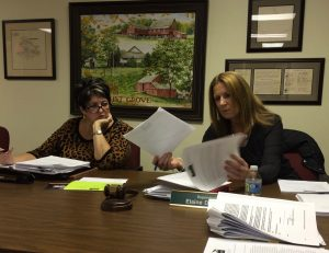 Pocopson Township Supervisors Alice Balsama (left) and Elaine DiMonte review documents during their meeting on Monday, Nov. 14.