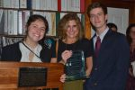Allie Pless (from left), Karyn Pless and Will Pless display the the John J. Crane Allied Professional Award.
