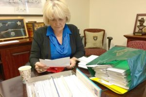 Chester County Sheriff Carolyn 'Bunny' Welsh, one of Pennsylvania's 20 members of the Electoral College, reviews some of the hundreds of cards and letters she has received in recent weeks.